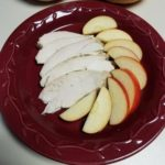 Sliced turkey breast with apple slices